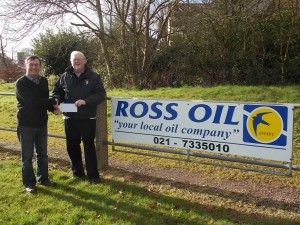 Tim Holland of Ross Oil makes a presentation to Tim Murphy President of Ballincollig RFC