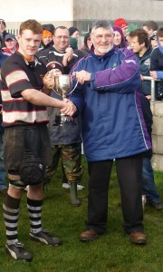 Robert O'Donoghue receiving the cup from Brian O' Connell